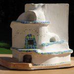 Das angemalte Modell des Kachelofens, der mein Firmenprospekt schmückt