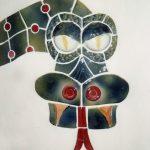Der keramische Kopf eines Drachens auf einem Tresen